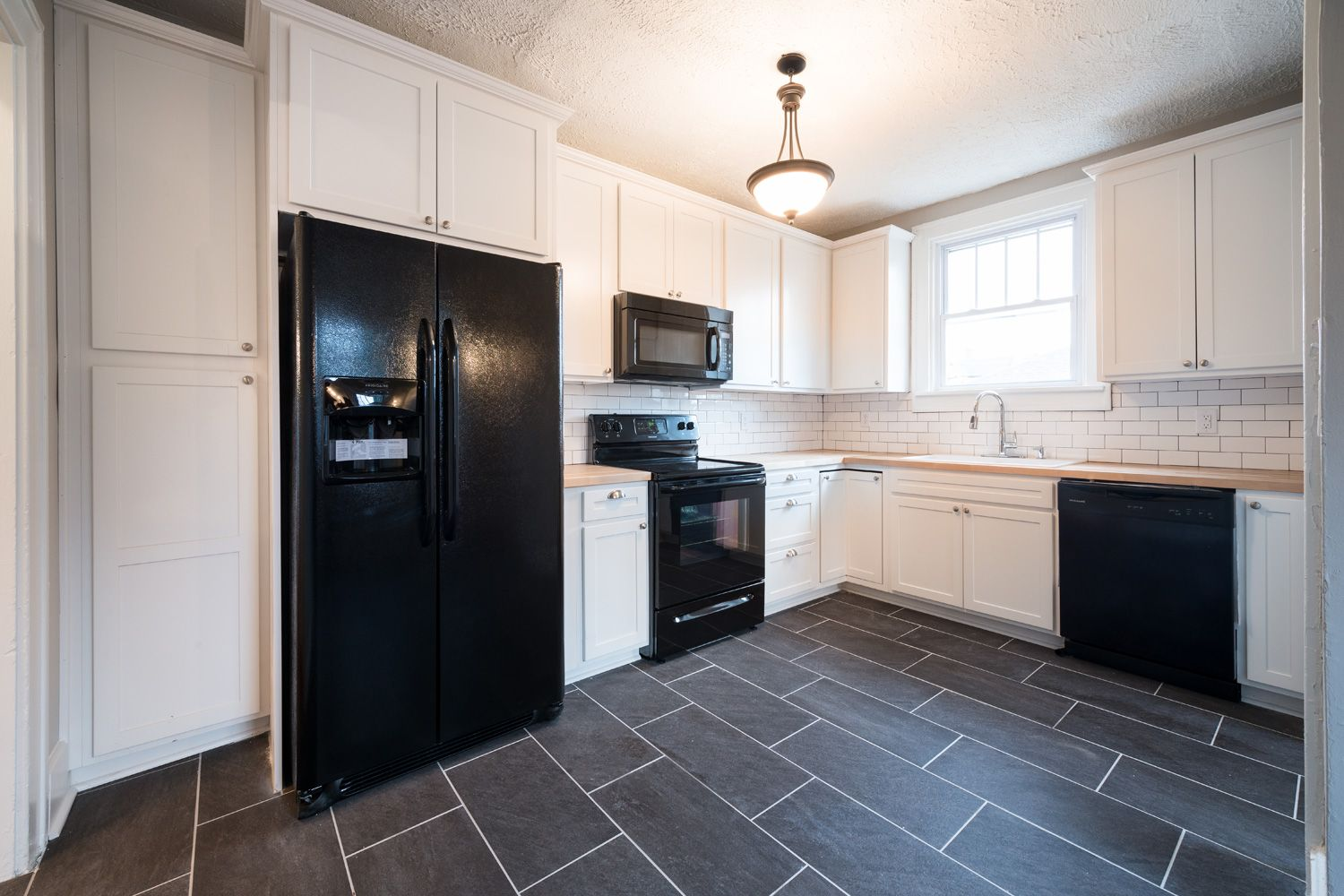 Kitchen Remodel; Indianapolis, IN; Porcelain Floor Tile; Black Appliances;  White Cabinets
