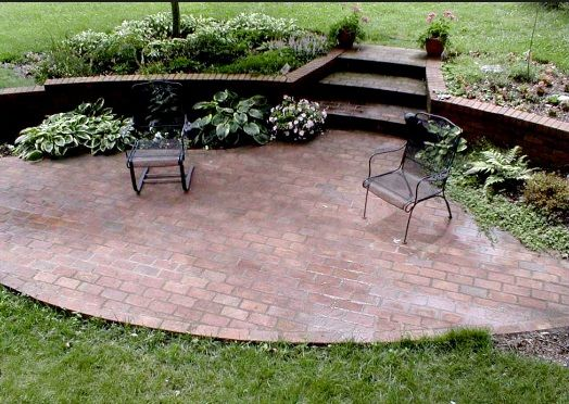 Oval Shaped Brick Patio With Retaining Wall