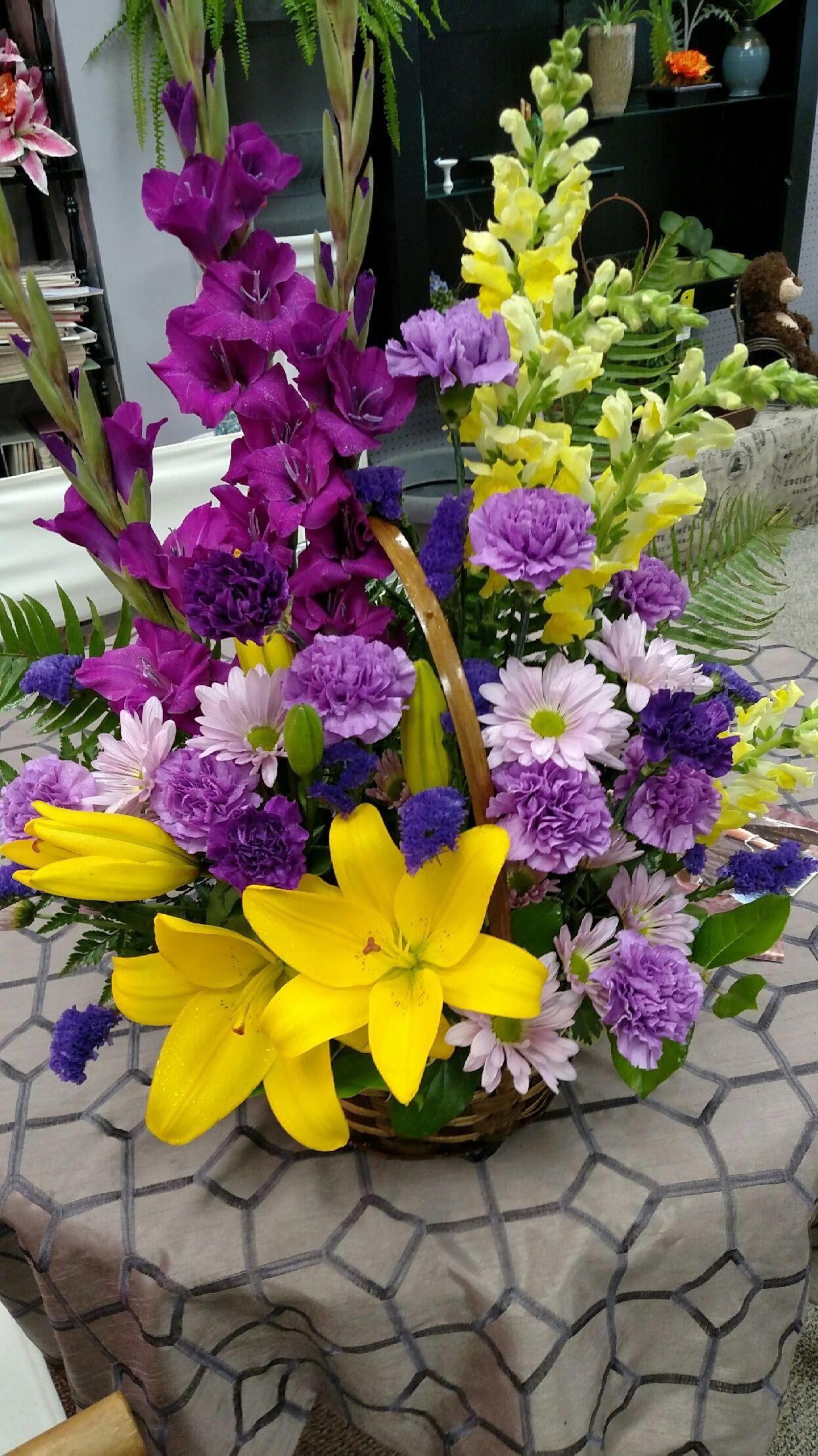 A bright and beautiful basket arrangement for a funeral