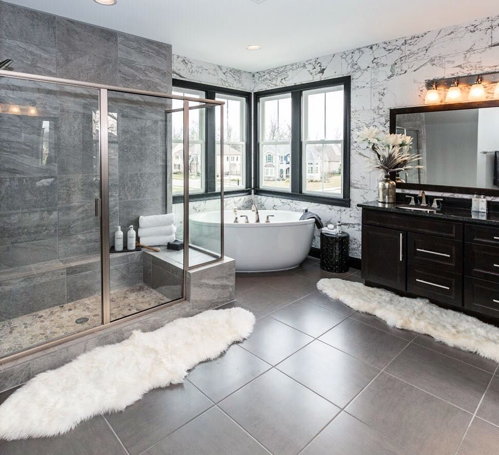 """Fischer Homes on Instagram: """"What's your favorite part about this modern owner's en suite - the corner bathtub or marble walls? #fischerhomes"""""""