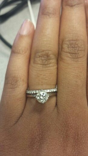 Nesw solitaire paired with a thin pave wedding band Ring