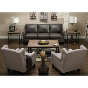 For A Sophisticated Style The Lavish Dark Grey Leather Sofa Is Paired With Light Polo Grey Fabric Armchairs Nail Home Living Room Furniture Best Leather Sofa