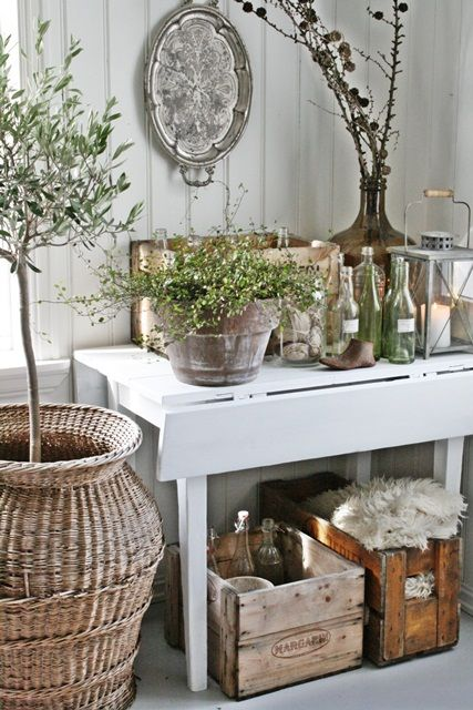 Cute table, bottles, and crates. Like the silver platter on the wall
