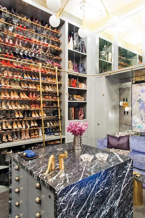 Glamorous Walk In Closet Boasts A Tall Gold Shoe Shelving Unit Accessible  By A Gold