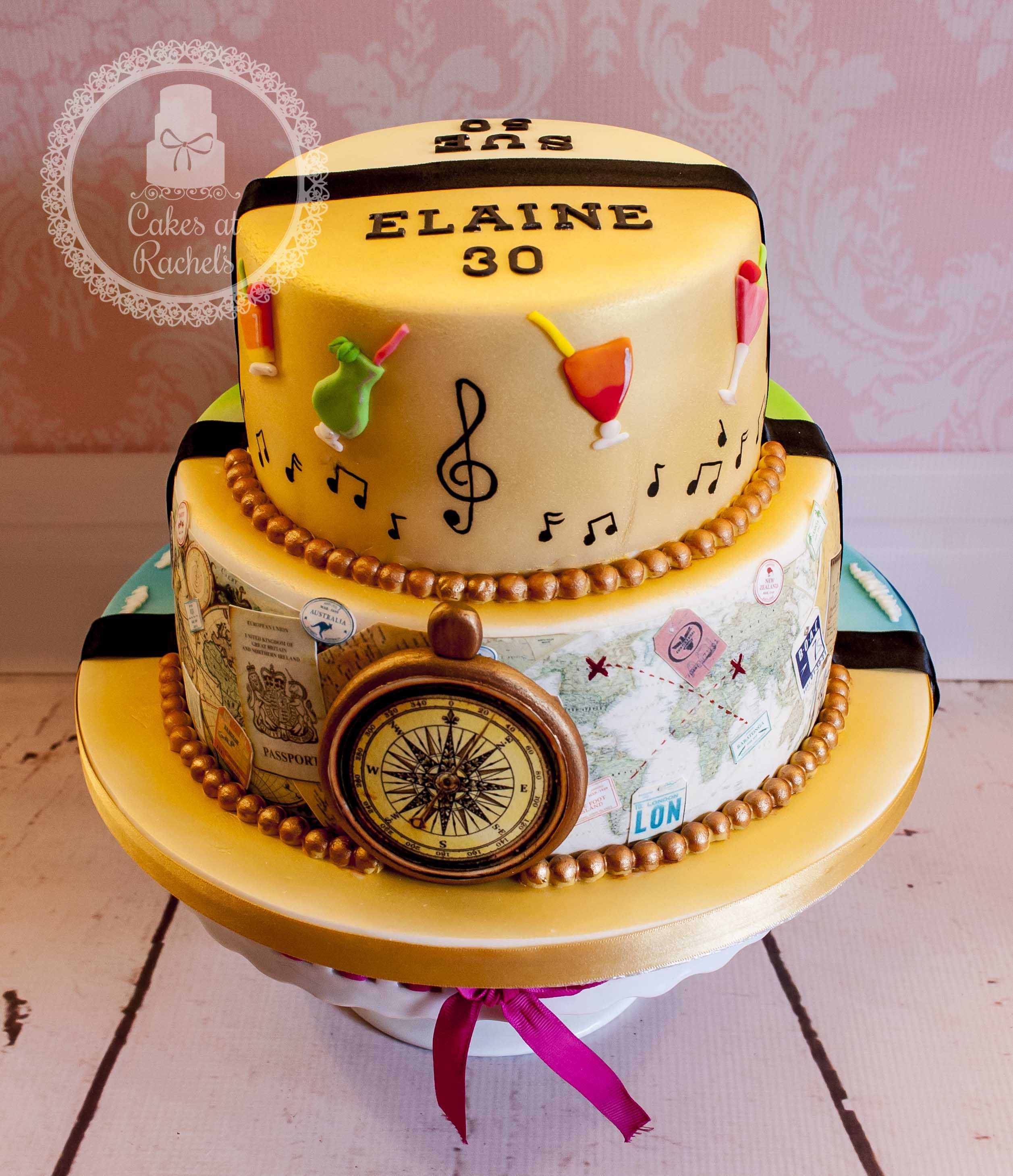 Double sided two tier cake, travel/music/cocktails on one