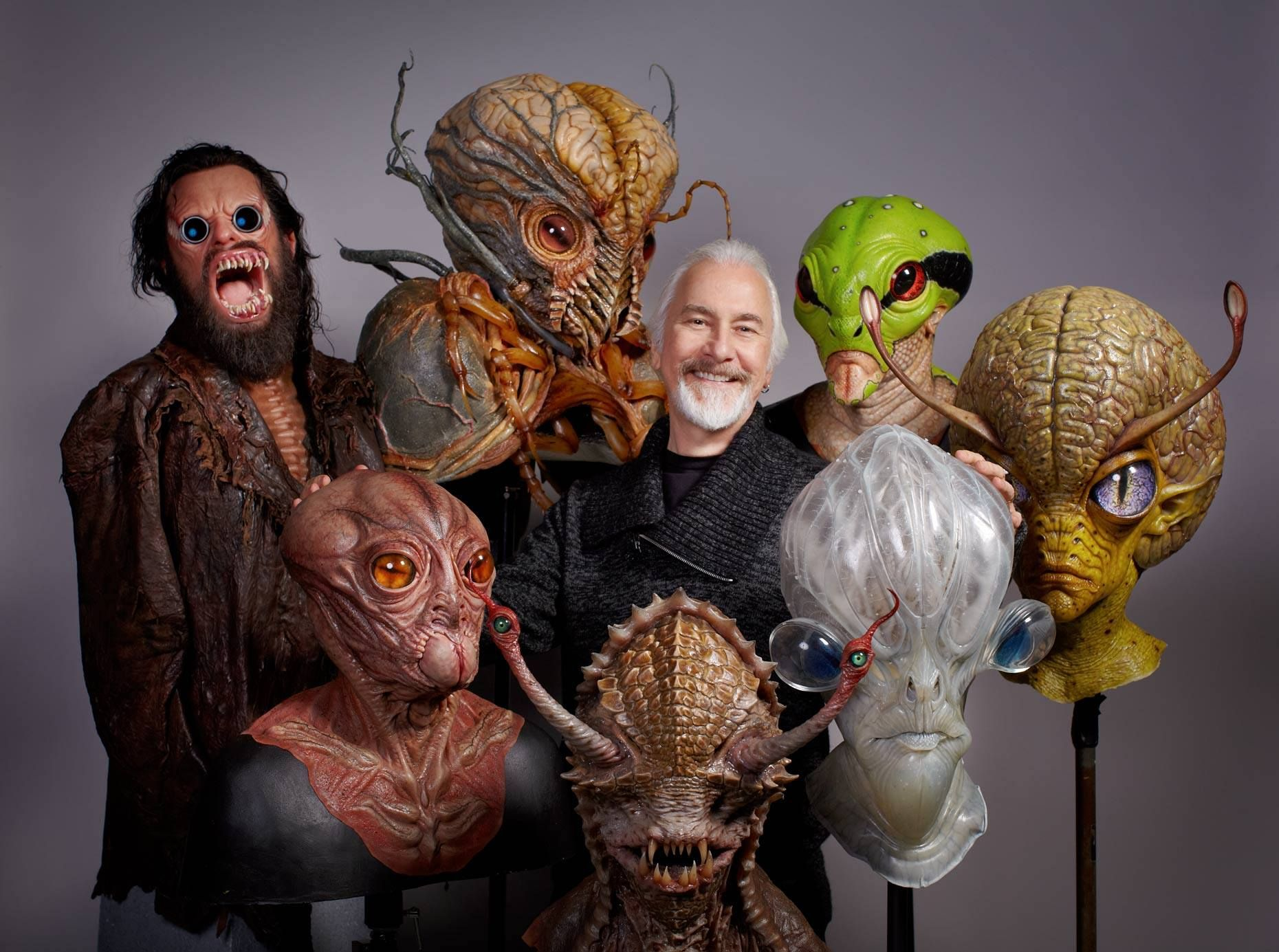 Rick Baker photographed with some of the alien creatures from 'Men ...