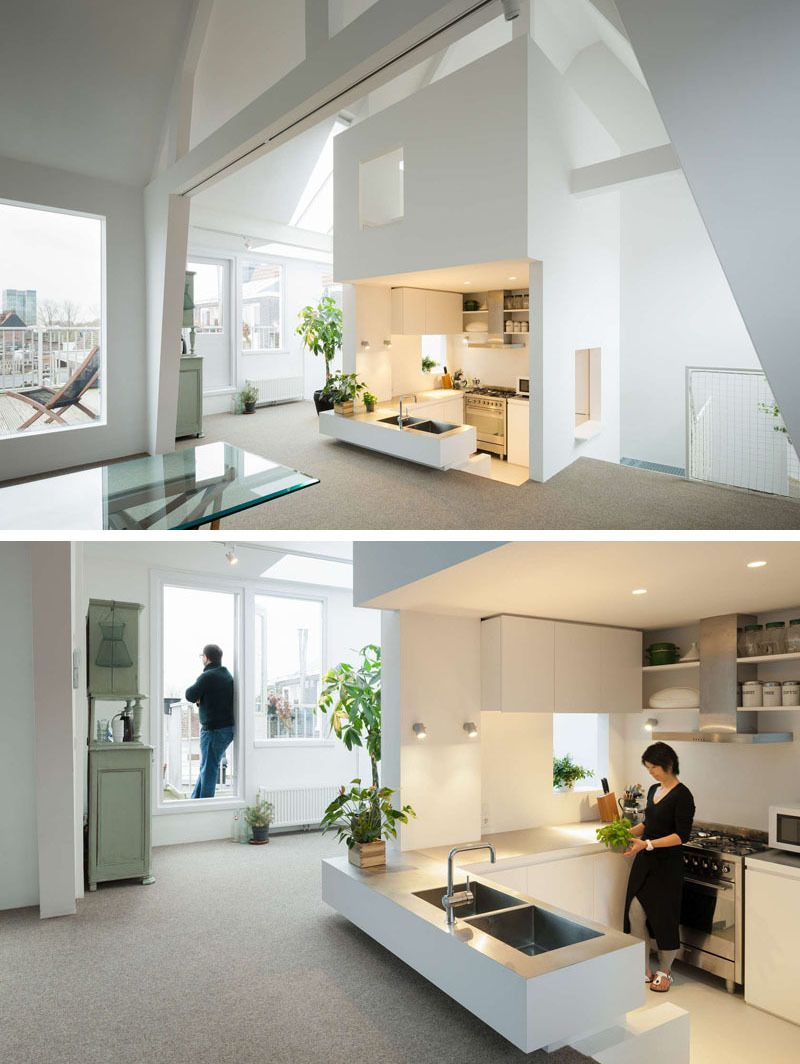 This Multi Floored Apartment Has A Sunken Kitchen Design.
