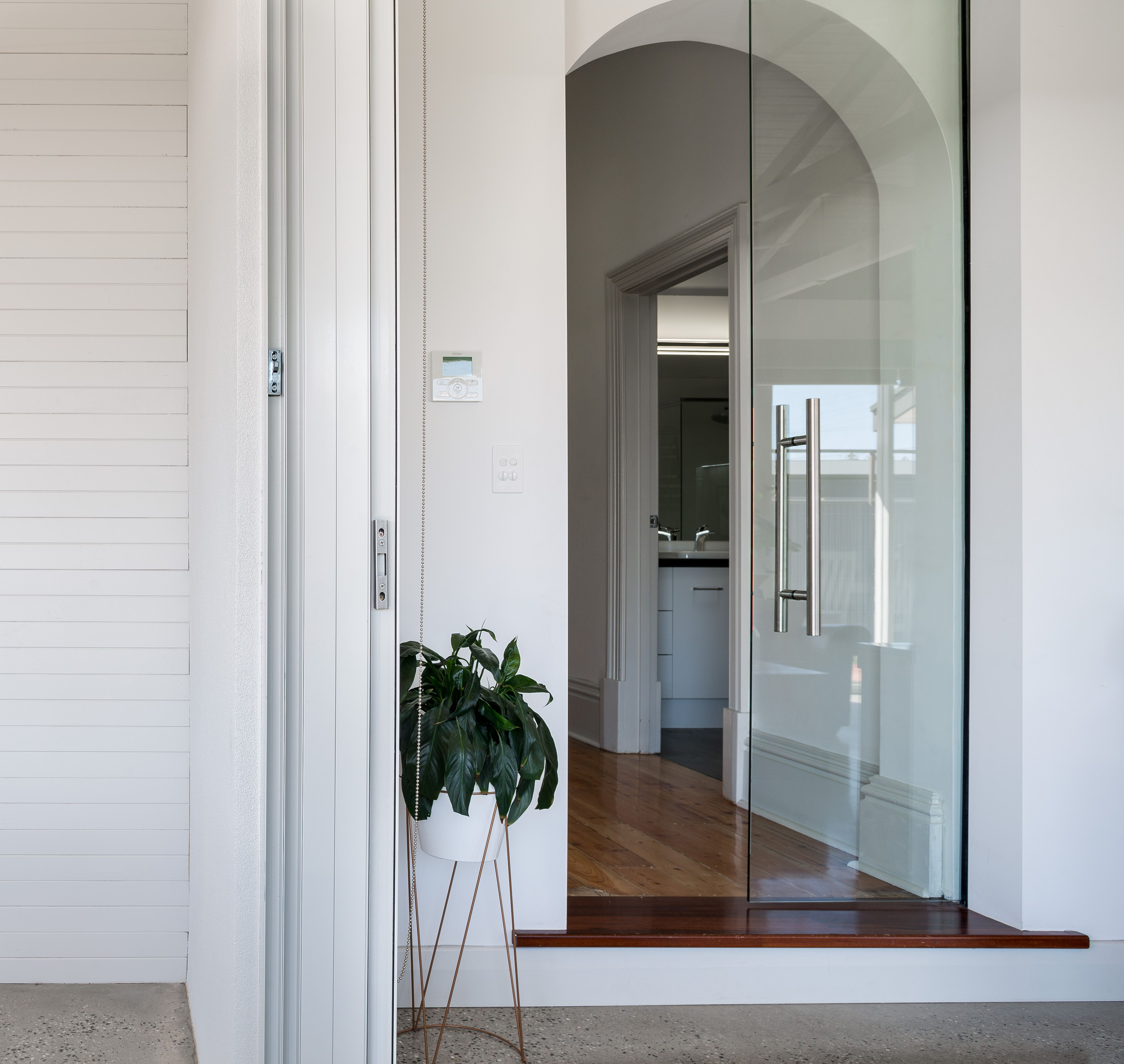 Old meets new modern sliding glass door marks the transition from