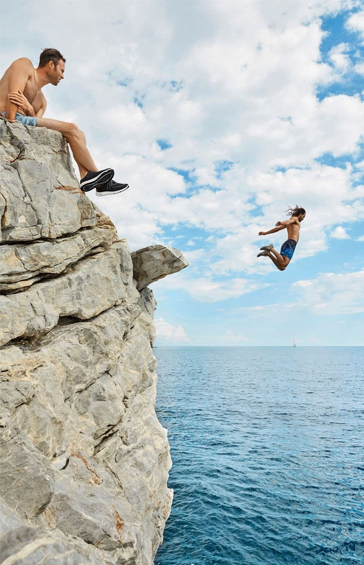 Look out below! An intrepid soul jumps off a seaside cliff in Greece in the Sperry 7 SEAS boat shoe.