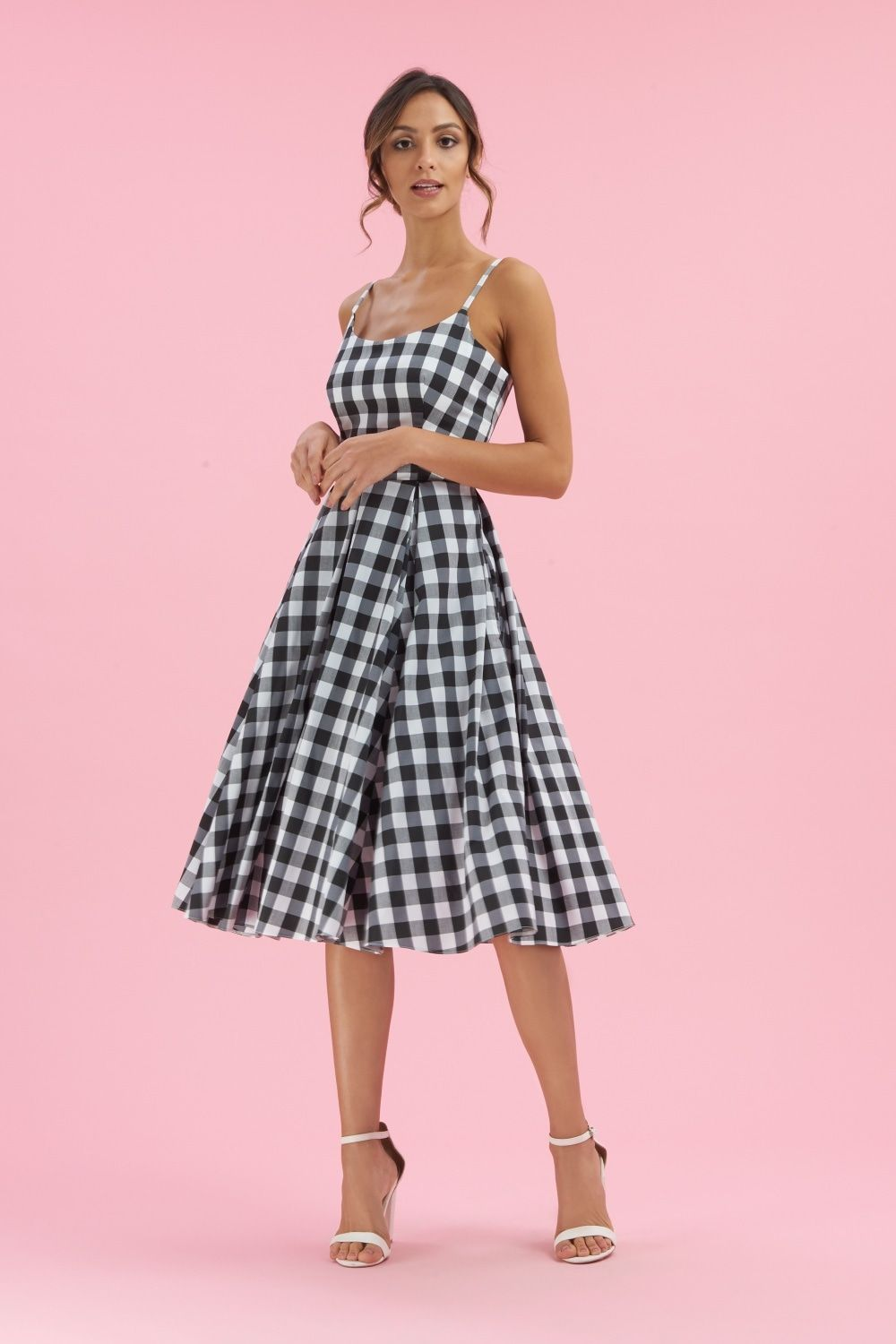 8506afa0f0de The Priscilla Gingham Midi Swing Dress is a signature design created from a  lightweight stretch cotton. This striking design features adjustable straps  and ...
