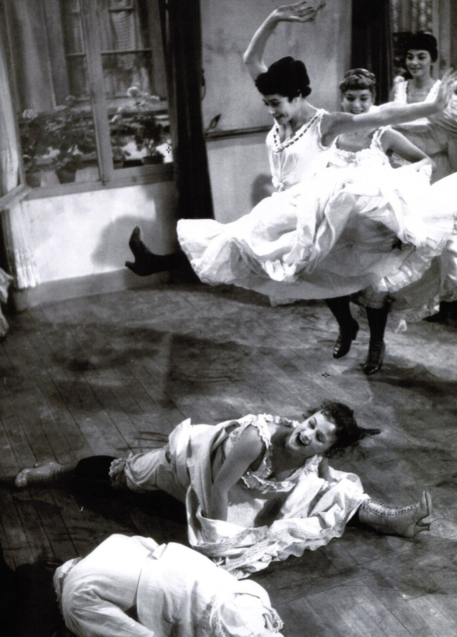 The cancan dancers rehearse their routine in preparation for the grand opening of the Moulin Rouge in French Cancan (1954, dir. Jean Renoir)...