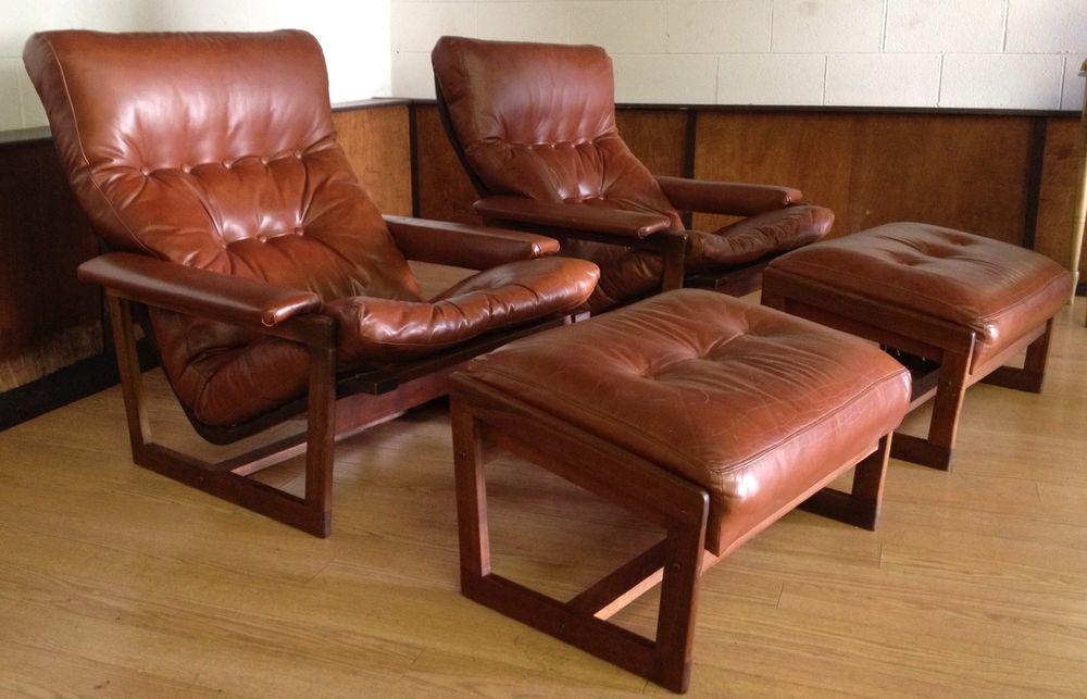 Danish lounge chairs ottomans pair leather teak mid