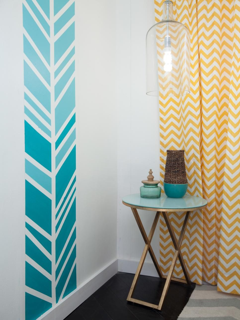 As seen on HGTV's Flipping the Block, husband and wife team John and Whitney Spinks created a midcentury modern retreat in their master bedroom in Glendale, Calif. They chose a bright white paint and then stenciled a herringbone pattern in graduated shades of aquamarine on two walls. Yellow chevron curtains provide contrast and additional pattern.
