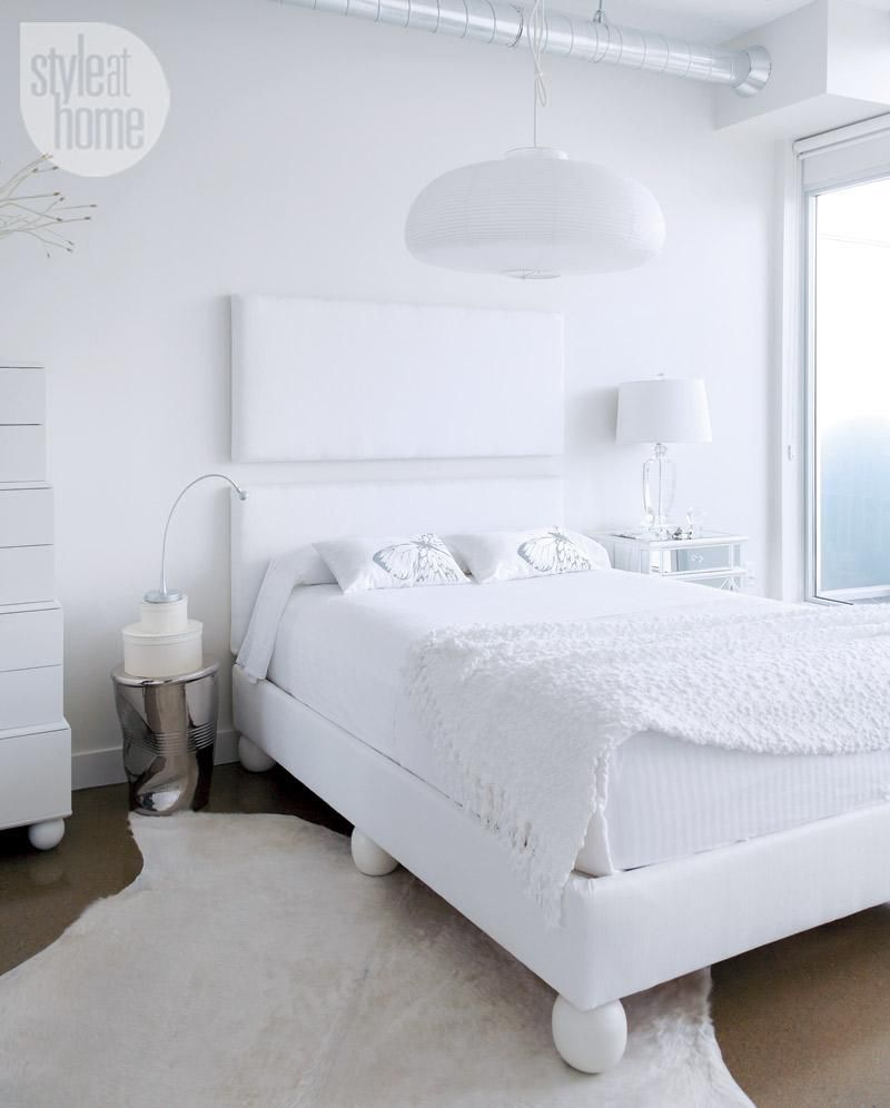 condo bedroom an all white bedroom featuring a floating headboard and hide rug - All White Bedroom Decorating Ideas