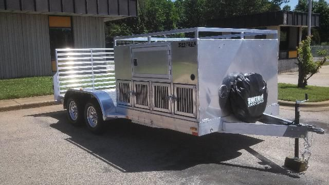 AWESOME custom made hunting trailer. 8 dog boxes, with storage above, and  room