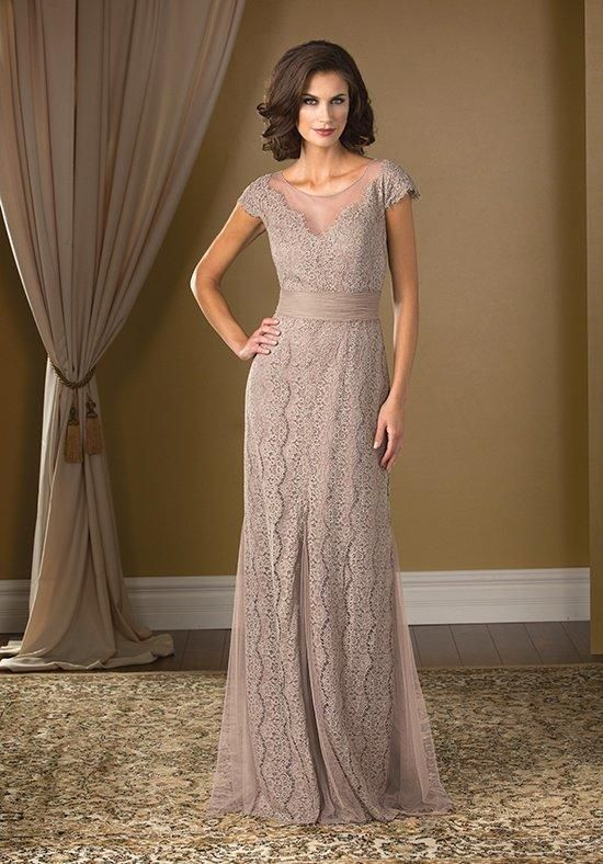A glamorous and extravagant gown to make a statement at your next event. This Soft Tulle dress has a boat neckline, A-line skirt, and is covered in a layer of beautiful lace touched up with beading along the neckline.