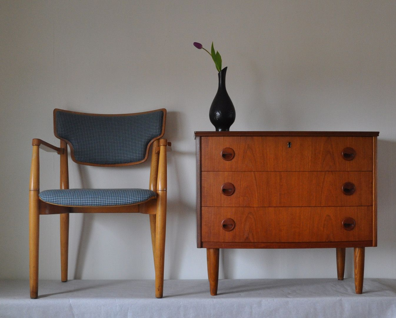 Teak chest of drawers with three drawers. Produced by a