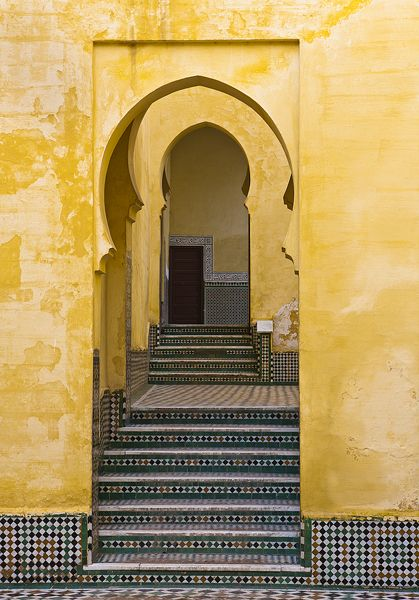 A temple doorway in Meknes, Morocco showing off typical tiling and bright paint.
