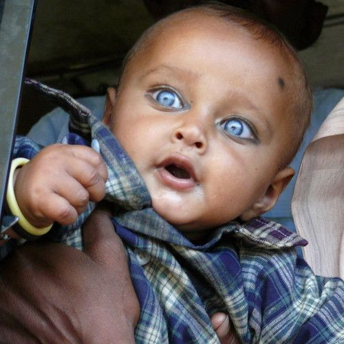 Young Boy With Brilliant Blue Eyes In Rajasthan India Photo