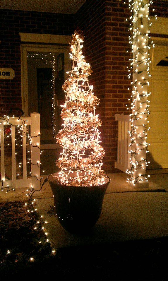 We Took This 5 Foot Tomato Cage And Zip Tied The Top To Form A Cone Then Strang 400 White Li Tomato Cage Christmas Tree Diy Christmas Gifts Christmas Display