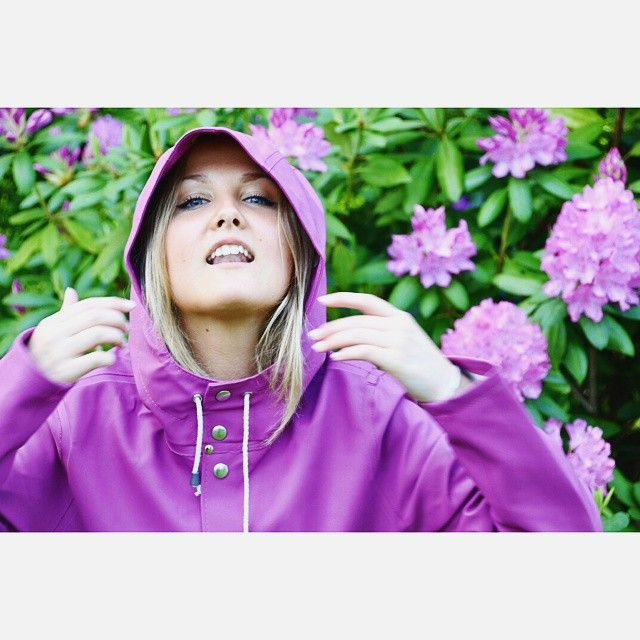 Stutterheim raincoat in purple, matching the colour of the Rhododendrons