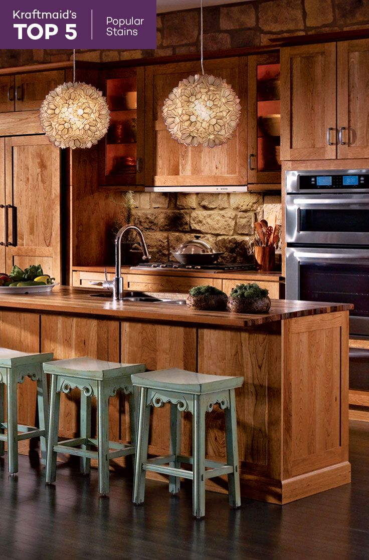 This KraftMaid® kitchen features cherry cabinets in Honey ...
