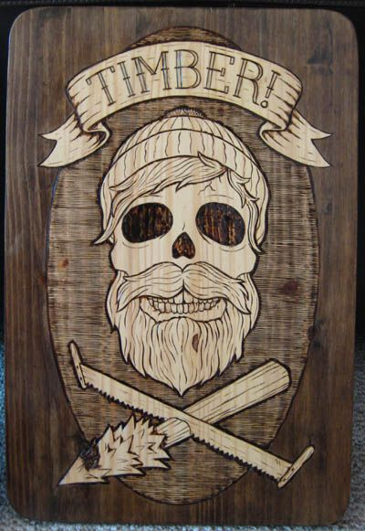 "Timber Preservation Society. Woodburn. ""Skull and Cross Cut Saw."" Chad Eaton."