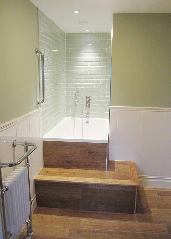 Used As A Corner Bath/shower, The Minimal Calyx Deep Soaking Tub Is Shown