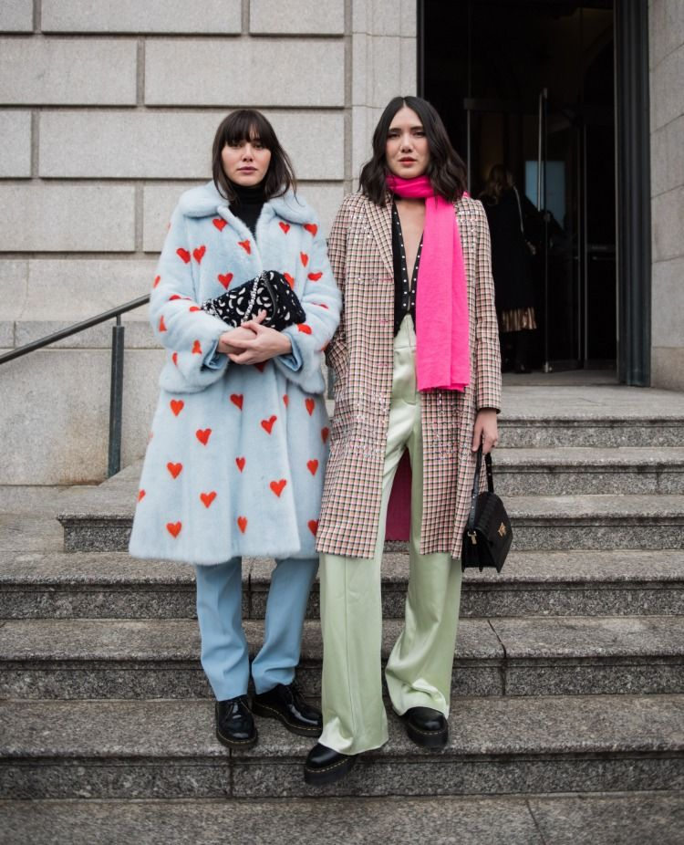 The Suarez sisters wearing blue heart fur coat and blue