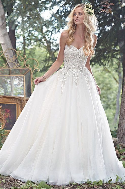 A fitted bodice glimmering with lace appliqu s dotted for Fitted ball gown wedding dress