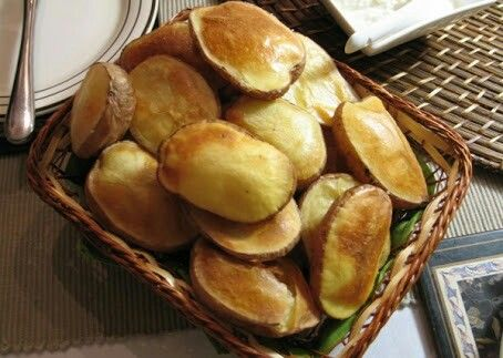 Lički krumpir - Lika's pptatoes - grilled potato halves - Lika region specialty (Croatia) - the potatoes growing in Lika region have specialical taste owing to special soil and climatic characteristics of the region