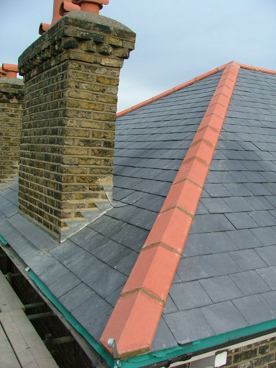 New Natural Slate Roof With Universal Hips And Ridge And New Lead Flashings  And Back Gutter