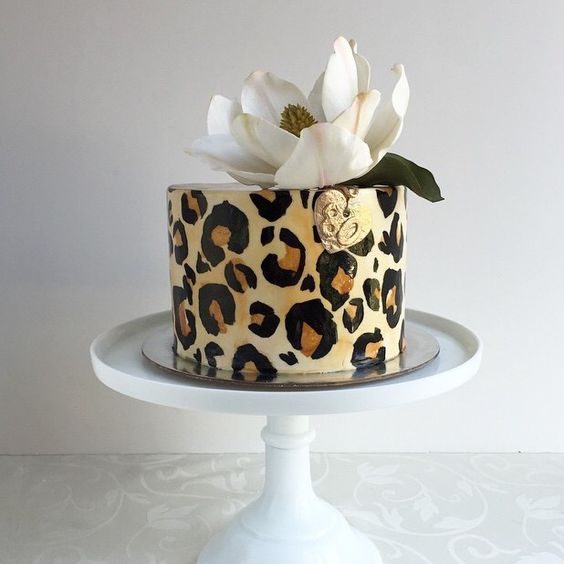 Leopard Print Cake with White Flower spotted on Pinterest
