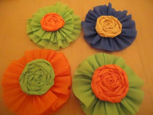 Rosettes embellished with rolled flowers made from crepe paper rosettes embellished with rolled flowers made from crepe paper mightylinksfo