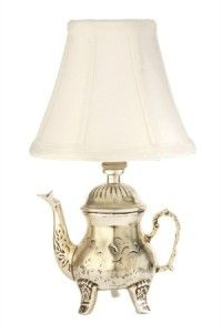 A look that is especially stylish is adding a table lamp on a bathroom counter. The Vintage Chic teapot lamp from Valley Light Gallery would look especially charming in a shabby chic master bath.
