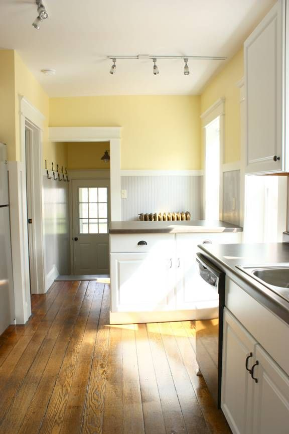 Kitchen color scheme pale yellow grey white charm for What color cabinets go with yellow walls