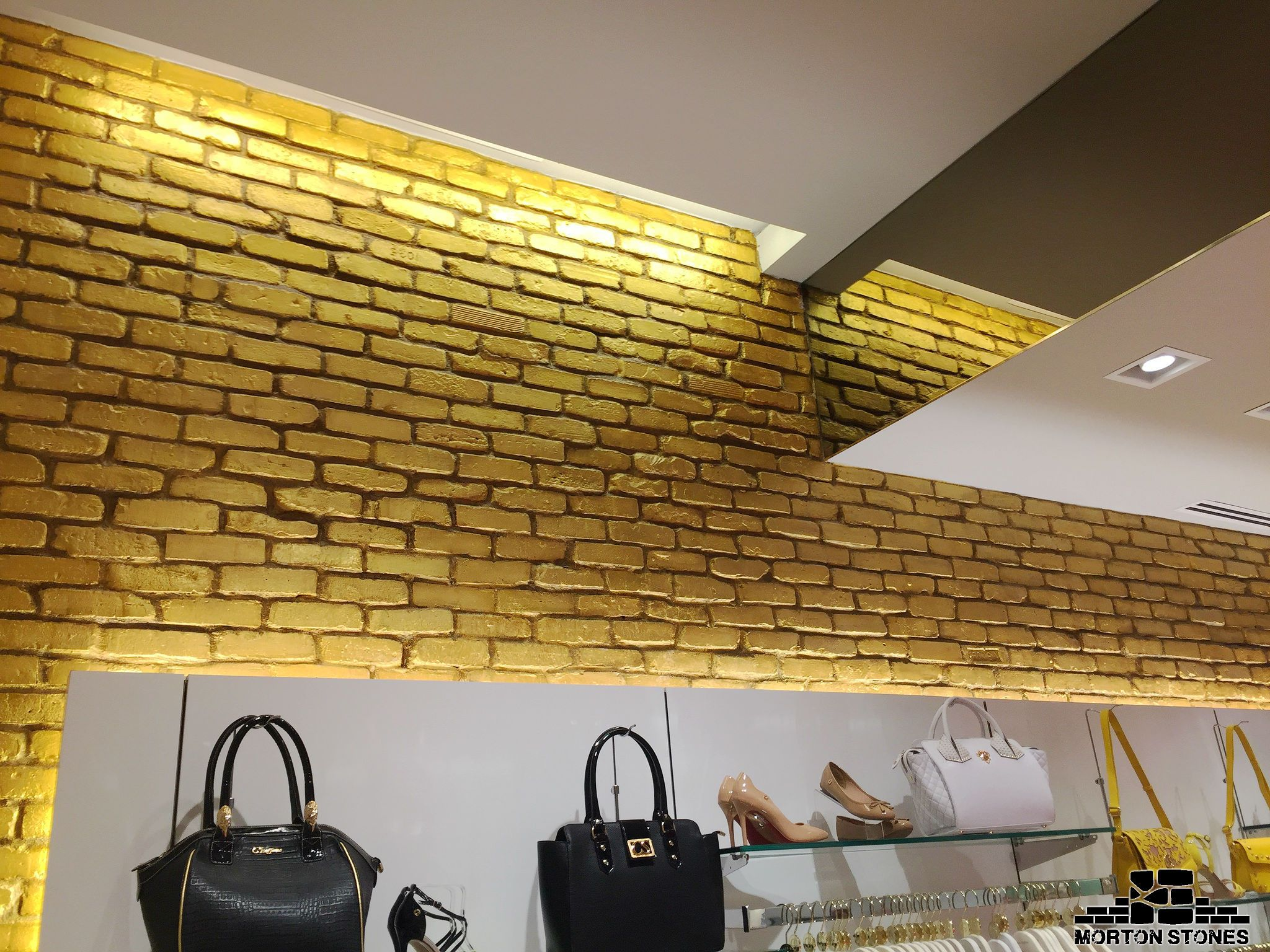 A brick accent wall in a clothes shop. #mortonstones #brick ...