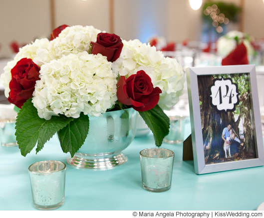 White hydrangea and red rose centerpiece in silver vase