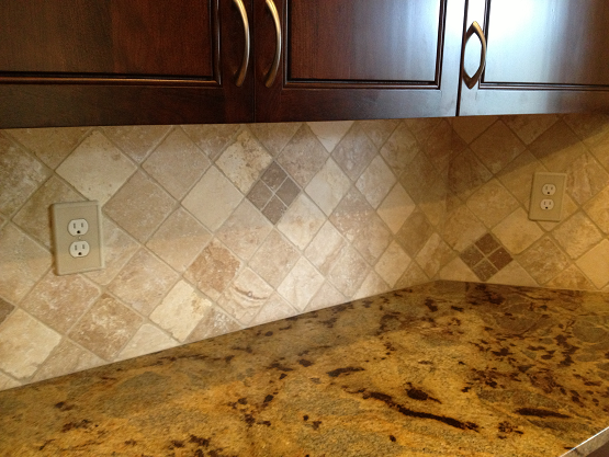 Backsplash Installation In Tampa Florida Westchase 4x4 Medium River Tumbled Travertine Set Diagonal With A 2x2 Westchase Tile Installation Tampa Florida