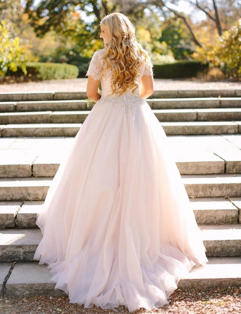 Blush pink peplum wedding dress lace long sleeved puffy tulle skirt