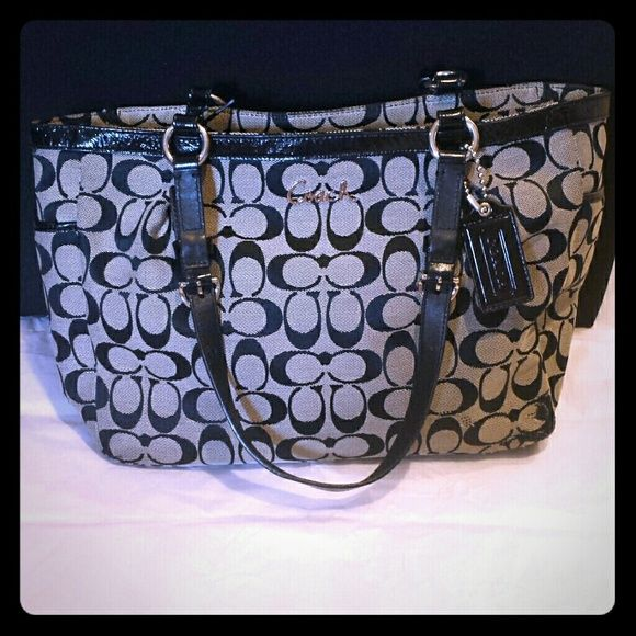 Traditional Black and Gray Canvas Coach Handbag Black and gray canvas handbag purse with baby blue interior lining by Coach. Out of all the purses in my closet, this is the most worn, so definitely willing to negotiate! There's some discoloration in the blue interior lining and light fraying at the bottom corners of the canvas due to use. Price reflects these damages. Selling for my pregnant sister for some extra money for the baby, so please make an offer! :) Coach Bags