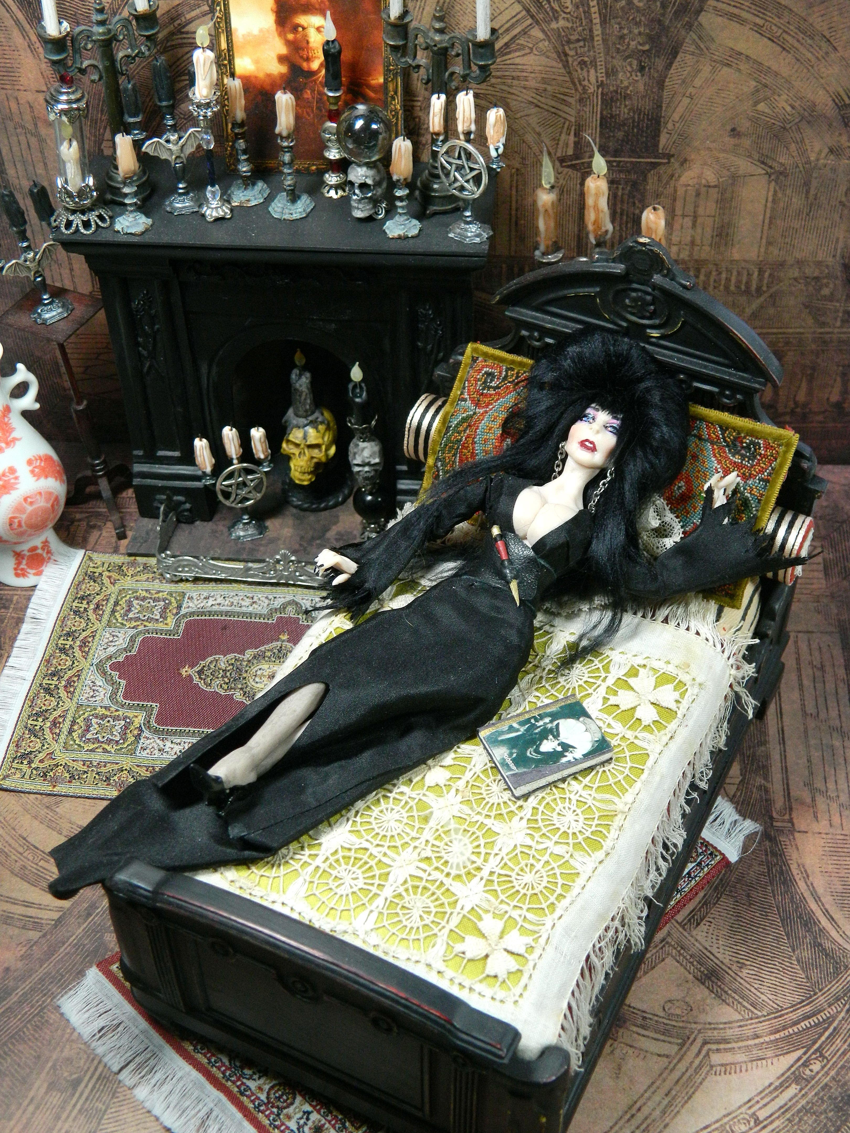 The beautiful and sexy Elvira, Mistress of The Dark. Created by LoreleiBlu, Elvira is a 5 3/4 inch tall and poseable miniature doll. To see more creations visit LoreleiBlu on Etsy.com or on FaceBook at LoreleiBlu. #haunteddollhouse