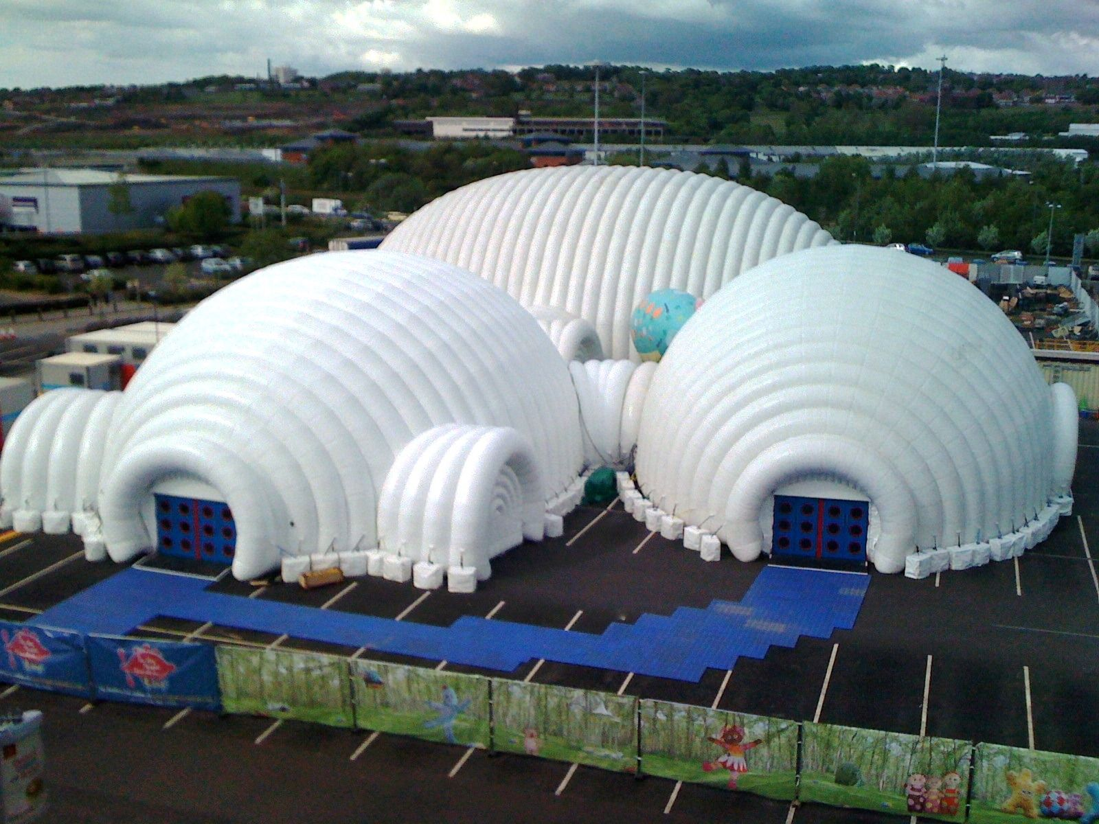 Inflatable Concrete Tent : Concrete counterweights are used for large temporary