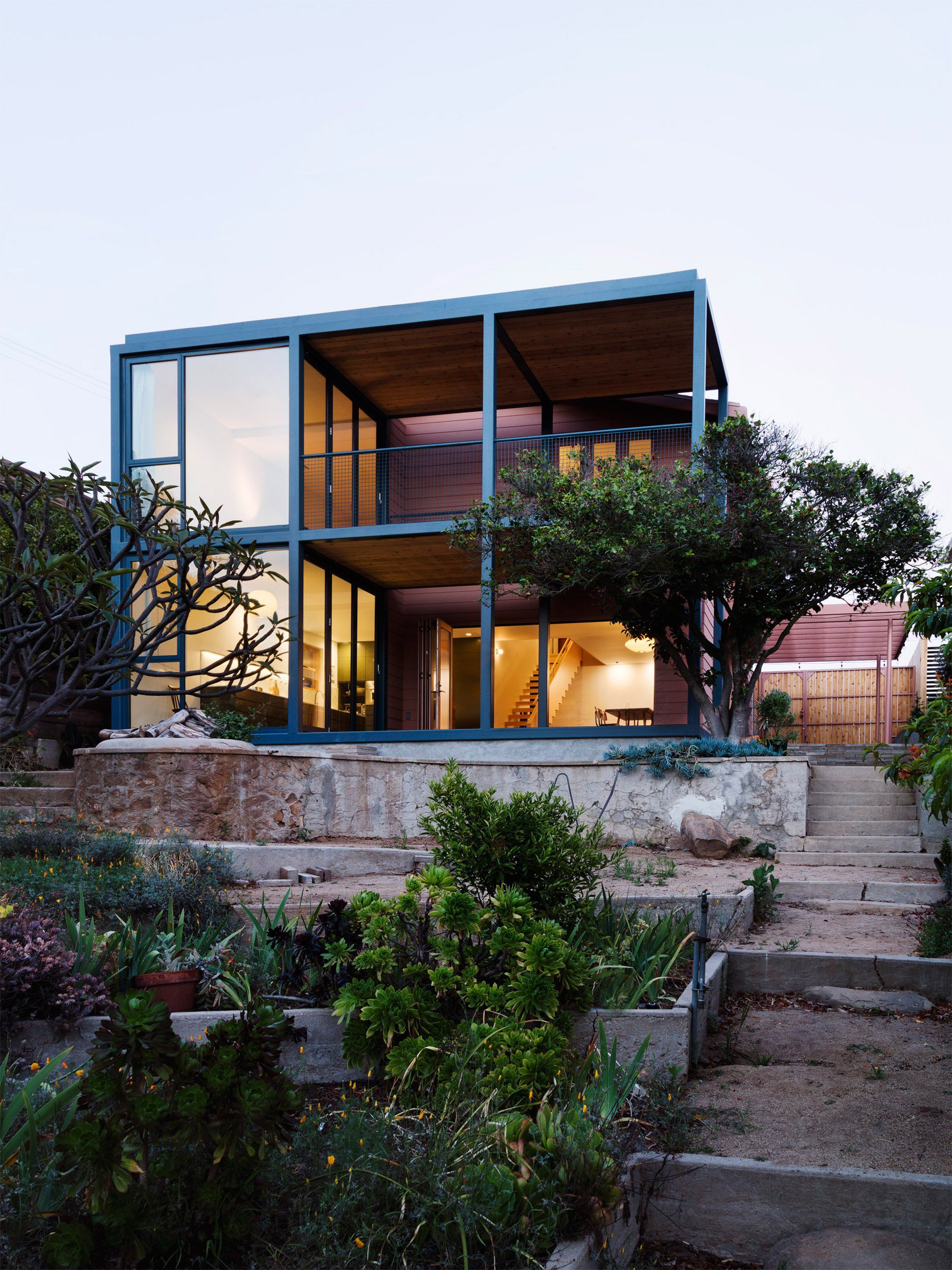 Productora adds steel frame extension to pink bungalow