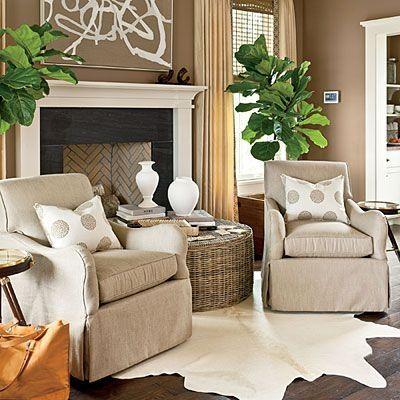 Neutral Chair Covers + Polka Dot Accent Pillows + Cowhide Rug Fig Trees | Nashville Idea House at Fontanel via Southern Living by mallory