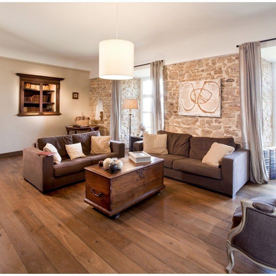 Décoplus Parquets  Déco salon canapé marron, Mur en pierre salon
