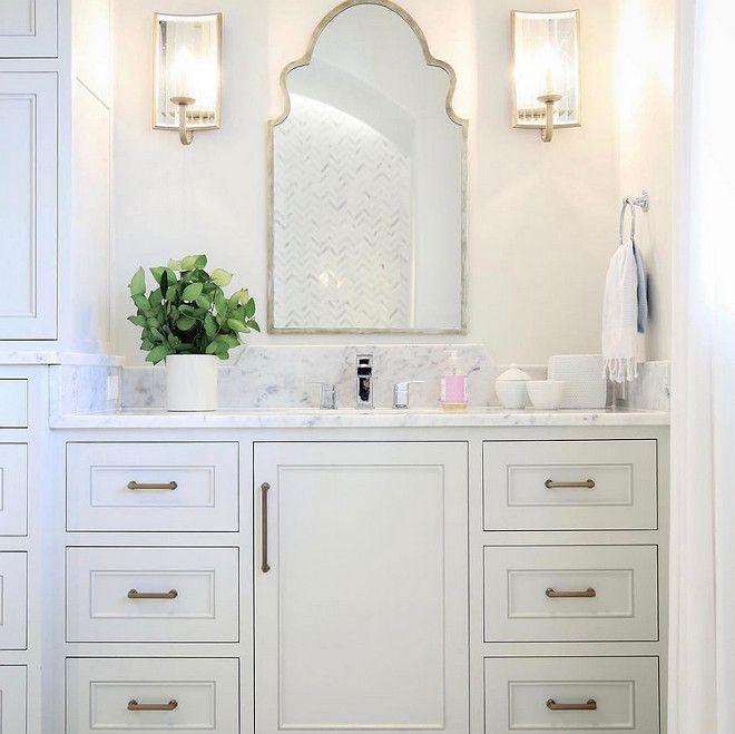 Bathroom Mirror And Sconces In This Bathroom A Moroccan Mirror