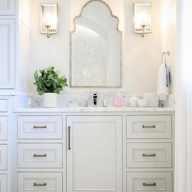 Bathroom Mirror And Sconces In This Bathroom A Moroccan Mirror Add Gorgeous Curvilinear Shape And Shine Bathroom Inspiration Girls Bathroom Bathrooms Remodel