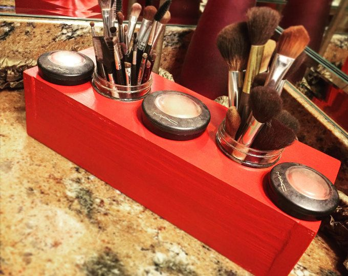 Enjoy our Red Makeup Brush Organizer. If you are tired of looking high and low to find your makeup brushes, this unit is for you. Its vibrant red color is sure to add elegance to your collection. Measurements are approximately 14x5x4 (inches). This unit houses (2) 8 ounce mason jars, which are included. Also enjoy free shipping with this purchase. As always, we do accept custom orders. If you need a particular size, color, stain, or added jars, feel free to contact us! Order yours today