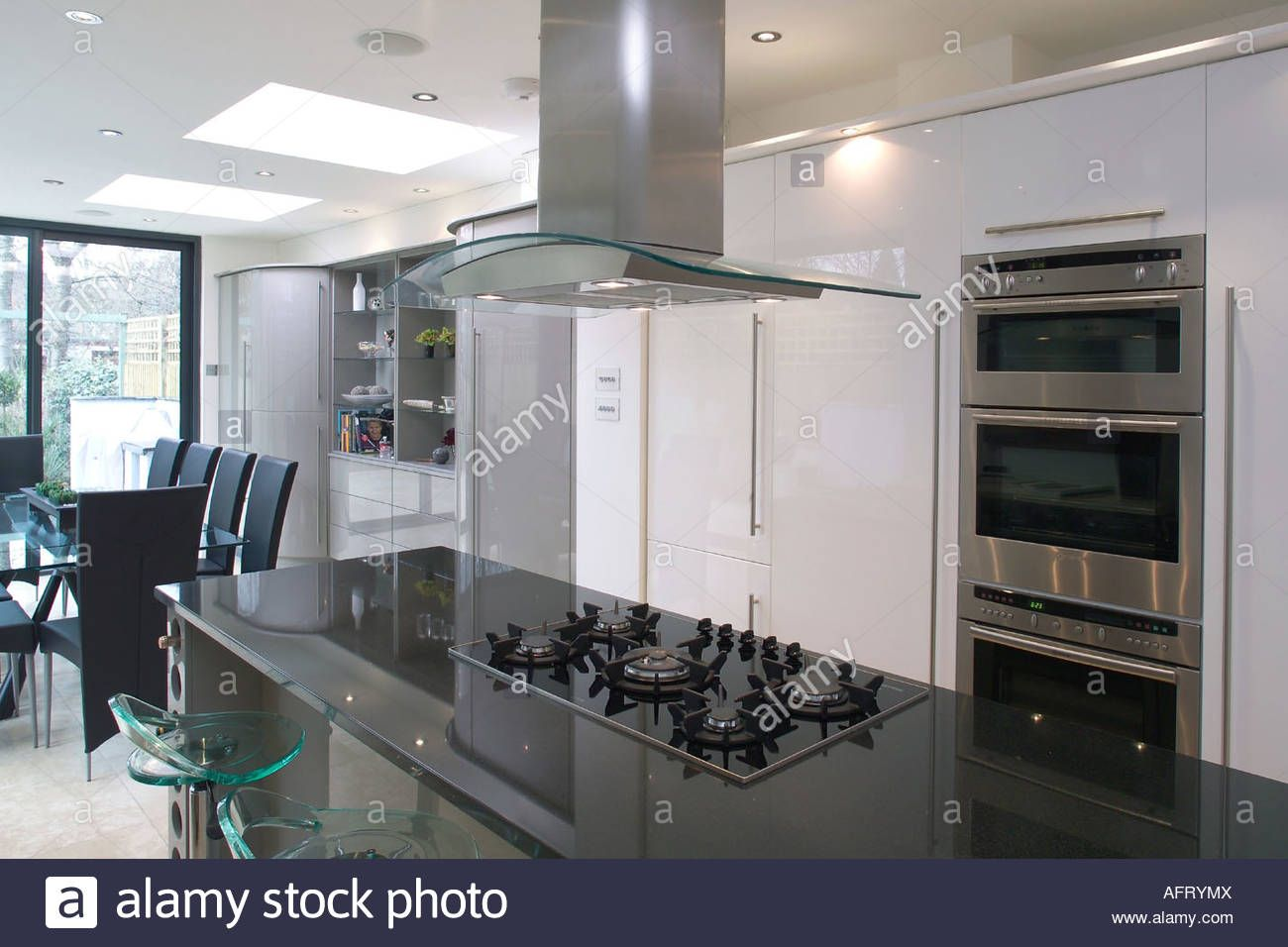 Download This Stock Image Extractor Fan Above Hob In Black Granite Island Unit In Modern Openplan Kitchen Modern Kitchen Island Wall Mount Oven Extractor Fans